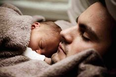 Baby Sleeps in Father's Chest