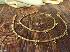 Anklets & Toe Rings Women's Alloy Gold Plated Anklets & Toe Rings Material: Alloy Size: Free Size Description: It Has 1 Pair Of  Women's Anklet Work: Stone Work Country of Origin: India Sizes Available: Free Size   Catalog Rating: ★3.9 (5120)  Catalog Name: Women's Alloy Gold Plated Anklets & Toe Rings CatalogID_223722 C77-SC1098 Code: 641-1711113-