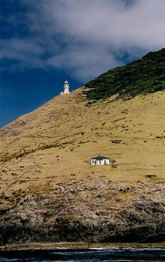 Cape Brett Lighthouse, Northland, New Zealand. I have been here and it is awesome; you can look over the Pacific Ocean and the Tasman Sea. It really wowed me and I'm sure you will be too!