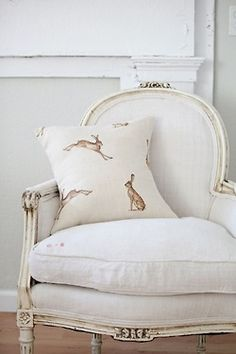 omg, a louis chair with a rabbit pillow!
