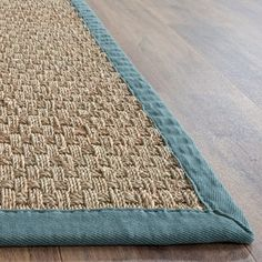Irresistible coastal sensibilities epitomize this 6' x 9' rug from Safavieh's Natural Fiber Collection. Bordered in light blue cotton twill, this rug's clean, neutral pigments allow for unlimited vers