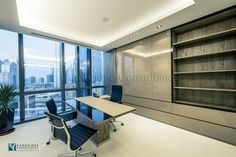 Emerald Group designed by Cambridge Consultancy Dubai (Manager's office with custom made storage unit and desk).