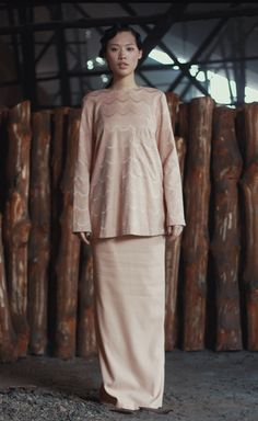 A classic traditional ensemble with a dash of subtle function-feature complementing the fabric giving a breathable structure to Srikandi, KALSOM. Email hello@tsyahmi.com for purchase & media enquiries.