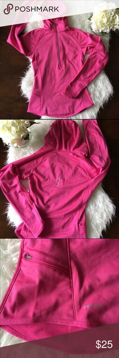 """Nike Dri-Fit Running Top Great used condition. This XS half zip running top is long sleeved with a hood, thumb holes, ventilated mesh under arms, and a zippered pocket on the front right which comes in so handy. Also features reflective zipper, Nike logo, and detail on the back. Previously LOVED now too small. Sad face. Looking for a good new home. Armpit to armpit: 17"""", shoulder to hem: 22"""". No tears, holes, or stains. Smoke free home. No trades please. Nike Tops"""