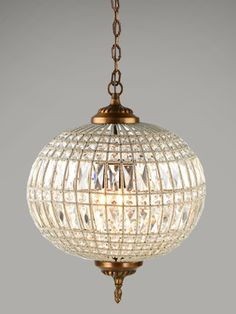 inspired by the elegance and grandeur of the roaring 20s, the crystal orb is a brilliant bit of glamour.  set an entry, dining room or bedroom aglow with dozens of cut glass crystals, capped with an antique brass canopy and finial.  the perfect combination of chandelier and pendant, the crystal orb has a contained elegance all its own.