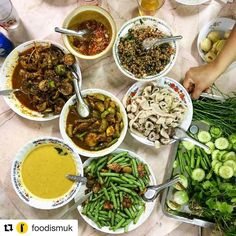 #Repost @foodismuk with @repostapp A snapshot of dinner on our tour of Trang southern Thailand with @rosasthaicafe home cooked by @saiphinmoore and friends. This included mackerel yellow curry stir-fried frogs pork intestine with dipping sauce stir-fried green beans with pork and Laab spiced mince pork with Thai basil and coriander. Southern Thai food is famed for its heat: some of this was so hot it made us slightly delirious. In a good way. #thai #thailand #southernthailand #trang #dinner…
