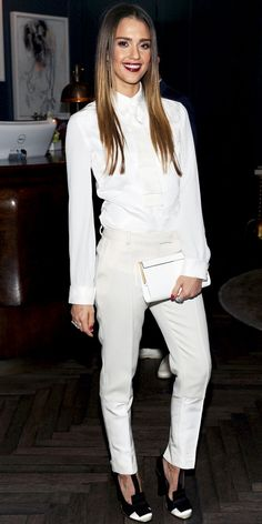Jessica Alba wore Tommy Hilfiger suit, Jimmy Choo clutch, Melinda Maria danglers, silver Graziela rings and satin pumps.
