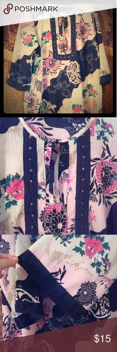 Pink and black flowery tunic Lovely pink and black flower tunic just waiting for a spring day very light. Tops Tunics