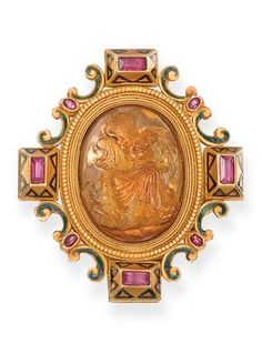 AN ARCHAEOLOGICAL REVIVAL CITRINE CAMEO BROOCH, BY CASTELLANI  The central oval-shaped citrine cameo depicting Zeus, King of the Gods, brandishing a lightning bolt in his right hand, seated in majesty, within the ruby-set border with green enamel scroll detail, circa 1860, 5.5 cm. high With addorsed Cs maker's mark for Castellani