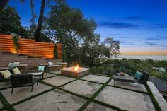 Side Yard Patio With Square Concrete Grid Walkway, Fire Pit, & Layered Retaining WallOrganically Inspired | Fresh Faces of Design | HGTV