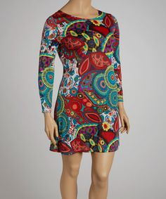 Groovy! With psychedelic blossoms and a fuss-free silhouette, this figure-hugging dress channels retro chic with ease.