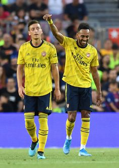 Pierre-Emerick Aubameyang of Arsenal celebrates with his tem mate Mesut Ozil after scoring his team's first goalduring the Joan Gamper trophy friendly match between FC Barcelona and Arsenal at Nou Camp on August 2019 in Barcelona, Spain. Arsenal Football Team, Aubameyang Arsenal, Arsenal Players, Football Players, Barcelona Vs Arsenal, Fc Barcelona, Arsenal Wallpapers, Soccer Pictures, Soccer Stars