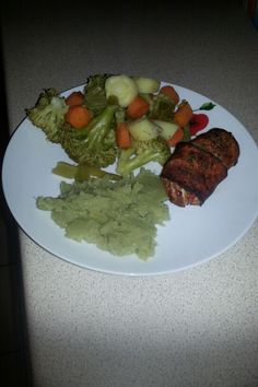 Chicken breast wrapped in bacon with sweet potato and veg