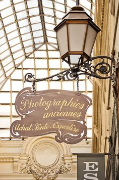 In this rainy season, how about a little walk sheltered in a Paris covered passageway? The Passage Verdeau for instance. Paris Travel, France Travel, I Love Paris, Street Lamp, Store Signs, City Lights, Street Lights, Hanging Signs, Cool Designs