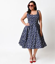 Darlings? We think you've found your first mate! A light and lovely cotton frock fresh from Hell Bunny, the Plus Size Marin 1950s dress is a sailor style that combines nautical flair with retro rockabilly sensibility for a swingin' summer dress! A scoop n