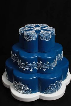 decorated cake ... royal blue with white lacey designs ...