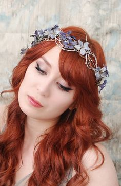 My favorite stop for floral hair accessories. Gardens Of Whimsy on Etsy.