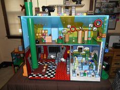 Parent repurposed a doll house into a One-Of-A-Kind Mario Land playset for my son! All hand crafted and handed painted details. All functioning sides, details, and moving parts. Only things purchased were some of the figures. Super Mario Room, Super Mario Party, Boy Room, Kids Room, Doll House For Boys, Mario Crafts, Ideas Habitaciones, Mario Birthday Party, Play Houses