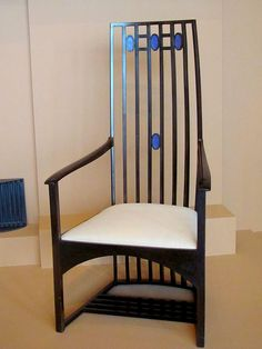 Scotland   Charles Rennie Mackintosh, armchair (1904) designed for Hous'hill, residence of Catherine Cranston in Glasgow, 1904.  Stained wood, glass and upholstery, with mauve glass ovals  attached to the vertical slats of the back.