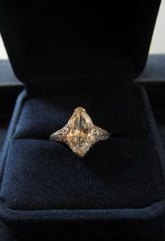 Vintage Marquise Diamond Ring, centering a Marquise diamond weighing app. 2.10ct (J color, VS2 clarity), additionally set with 32 single cut diamonds weighing app. 0.35ctw., fashioned in platinum