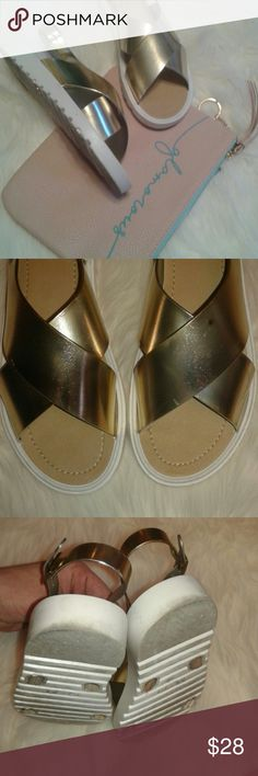 Metallic Sandals Sz Eur38/ US 7. GREAT USED condition. Golden metallic sandals with cross front and heel straps with adjustable buckle closure.  A couple tiny scratches and discolorations as shown. Very minor. NWT glamorous Clutch also listed on my closet. Yoki Shoes Sandals