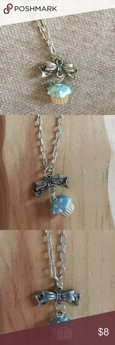 """Blue Cupcake Bow Silver Chain Necklace Cute Kawaii Silver costume necklace with bow at the end and cute blue cupcake charm. Necklace is 16"""" and adjustable with a lobster clasp. Worn once and in great condition. Posh Adornments Jewelry Necklaces"""