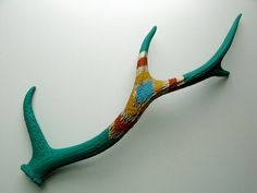 Painted antler: would prefer driftwood or stone or something, but like the painting while leaving the natural surface to show through in places.