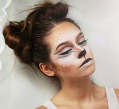 The outlining of the eyes with brown eyeliner and filling it with white looks great. Did you notice how her buns look like deer ears!?