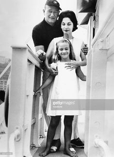 Actor John Wayne with his wife Pilar Pallete and daughter Aissa, in Monte Carlo following sailing the Atlantic, Monaco, August 29th 1963.