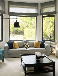If you have a bay window in your home you are probably wondering what is the best way to dress or use this space. Bay Window Dressing, Curved Radiators, Bay Window Treatments, Small Home Offices, Built In Seating, Bay Windows, Dining Nook, Curtains With Blinds, Small Rooms