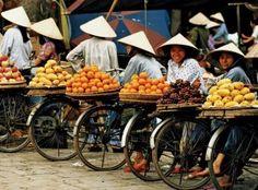 Vietnam, Hanoi, fruit vendors on bikes Hanoi Vietnam, Ao Dai Vietnam, Vietnam Travel, Vietnam Tours, South Vietnam, People Around The World, Around The Worlds, Vietnam Voyage, Street Vendor