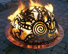 Hand cut from sculptural grade steel, each fire dome is available separately in a variety of artistic designs that each tell a unique tale with its figures, landscapes,  intricately woven patterns.