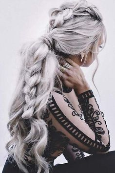 Woman with elaborate braid and silver hair