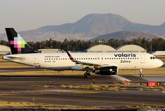 """Volaris Airbus A320-233 XA-VOZ """"Zahira"""" moving on to the threshold of 23R for a departure from Mexico City-Benito Juárez International, April 2016. (Photo: Jonathan Parra)"""