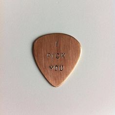 Hand stamped personalised copper plectrum by AbercrombieCumbes