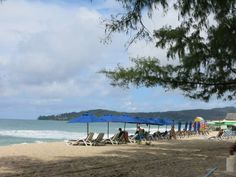 Relaxing on lounge chairs at Bangtao Beach.
