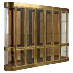 A Large Mastercraft Three Part Brass Display Cabinet 1980s | From a unique collection of antique and modern cabinets at http://www.1stdibs.com/furniture/storage-case-pieces/cabinets/