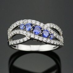 Curved Tanzanite December Birthstone Ring (925 Sterling Silver) Item Type: Rings Fine or Fashion: Fine Main Stone: Tanzanite Rings Type: Wedding Bands Style: Romantic Gender: Women Setting Type: Prong