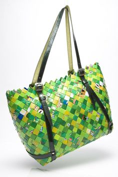"14.5"" x 10.5"" x 5"" Shoulder Bag made out of gum and candy wrappers.  ♦ Nahui Ollin - bags, wallets, etc. made from woven candy wrappers, old street maps, clipped bar codes, newspaper comics, etc. (original source - http://www.nahuiollin.com/handbags/shoulder-bags/twenty-4-seven-flavors-pink-berry-552.html )"