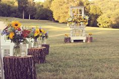 For a rustic country wedding, flank each row of chairs with wood stumps that serve as small tables for mason jars filled with wildflowers.     #rustic #wedding #country