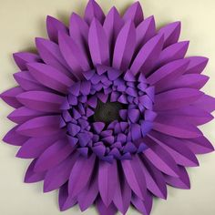Download templates to craft a large gerbera daisy, perfect for a wall of flowers. Includes templates for hand cutting, Cricut Explore, and Silhouette.