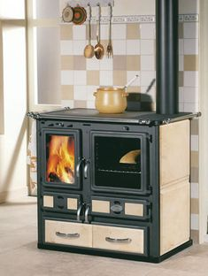 jpg What is wood burning ? The tree burnt by treatment method by moving a picture on wood is called wooden decorat. Wood Burning Cook Stove, Wood Stove Cooking, Stove Heater, Old Stove, Cast Iron Stove, Wood Fired Oven, Stove Fireplace, Rocket Stoves, Cast Iron Cooking