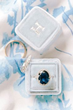 Oval Sapphire Engagement Ring with a Diamond Band | Katie Stoops Photography | http://heyweddinglady.com/playful-patterns-blue-coral-gold-summer-wedding/