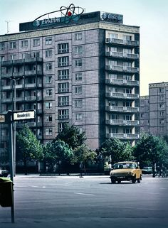 Vintage East Germany 1980s, hand colored photograph, Streets of East Berlin, 1989, 11x15, black and white, apartment block, Trabant. £25.00, via Etsy.