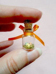Three tiny chicks in a bottle  miniature by MijbilCreatures