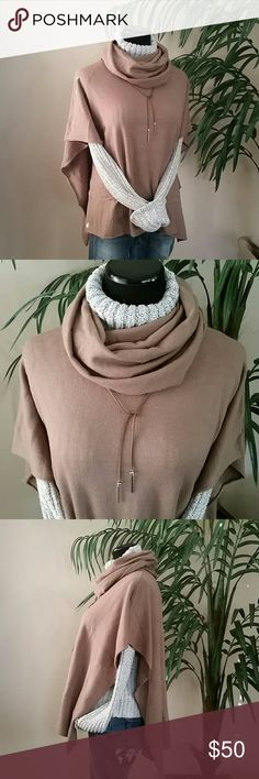 """Cowl Neck Poncho NWT! Cowl Neck Poncho is new with tag!   - Cowl neck - Poncho sleeves - Knit construction - Handkerchief hem - Approx. 12"""" shortest length, 30"""" longest length - Imported Fiber Content 54% cotton, 41% acrylic, 5% angora  🚫No Trades 🙄😘  🔘Use OFFER button to negotiate👍🤑 🔘Please Ask ❓'s BEFORE you Buy🤔😃 💕Thank you for stopping by! Happy Poshing!💕 Real Haute Trends  Sweaters Shrugs & Ponchos"""