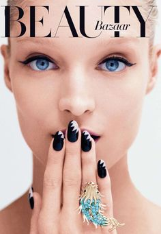 The Shark Bite Manicure http://www.harpersbazaar.com/beauty/makeup-articles/best-spring-nail-polish-0313#slide-1
