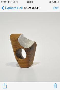 Ring, wood, silver paper.