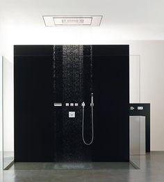 Bold minimal shower on black monolithic background.