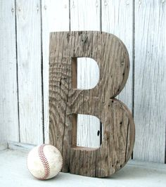 Adorable letters made out of barn wood would be great outside decor.  Or even inside on a shelf, wall, or floor.